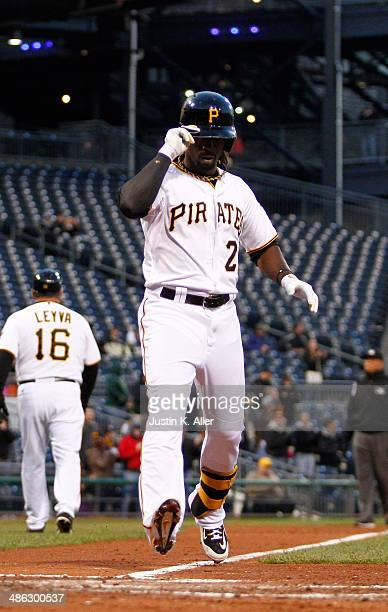 Andrew McCutchen of the Pittsburgh Pirates celebrates after hitting a solo home run in the third inning against the Cincinnati Reds during the game...