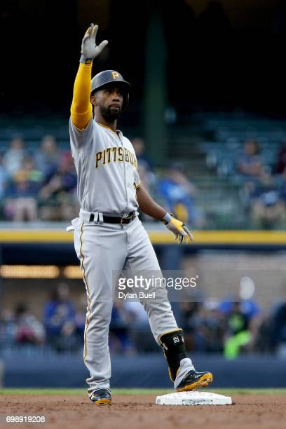 Andrew McCutchen of the Pittsburgh Pirates celebrates after hitting a double in the first inning against the Milwaukee Brewers at Miller Park on June...