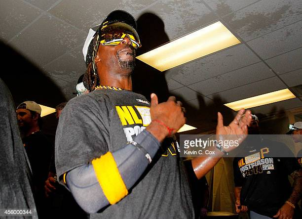 Andrew McCutchen of the Pittsburgh Pirates celebrates clinching a National League playoff spot after their 32 win over the Atlanta Braves at Turner...