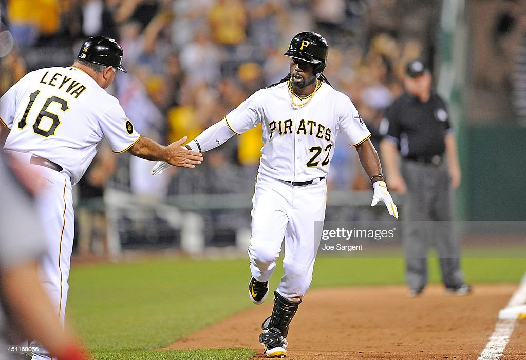 Andrew McCutchen #22 of the Pittsburgh Pirates celebrates his home run with third base coach Nick Leyva #16 during the ninth inning against the St. Louis Cardinals on August 25, 2014 at PNC Park in Pittsburgh, Pennsylvania. St. Louis won the game 3-2.