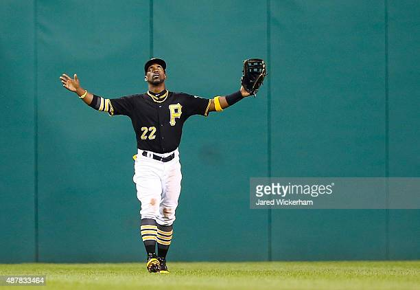 Andrew McCutchen of the Pittsburgh Pirates celebrates their 63 win against the Milwaukee Brewers during the game at PNC Park on September 11 2015 in...