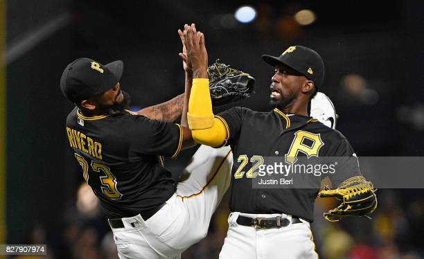 Andrew McCutchen of the Pittsburgh Pirates celebrates with Felipe Rivero after the final out in their 63 win over the Detroit Tigers at PNC Park on...
