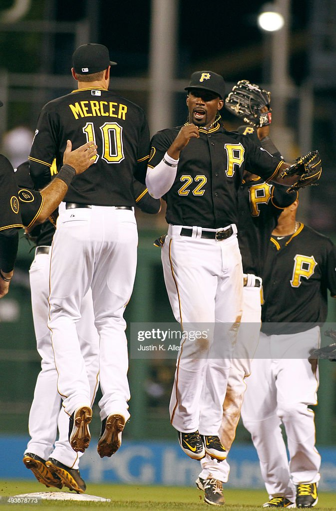 Andrew McCutchen #22 of the Pittsburgh Pirates celebrates with Jordy Mercer #10 after defeating the Washington Nationals 3-2 at PNC Park May 24, 2014 in Pittsburgh, Pennsylvania.