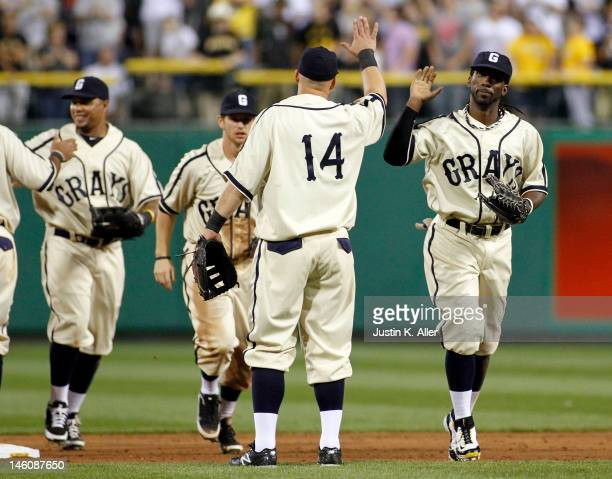 Andrew McCutchen of the Pittsburgh Pirates celebrates with teammates after defeating the Kansas City Royals during interleague play on June 9, 2012...