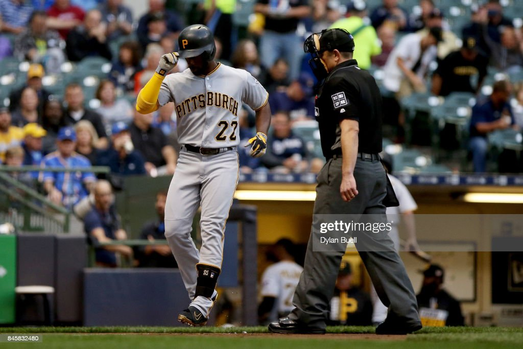 Andrew McCutchen #22 of the Pittsburgh Pirates crosses home plate after hitting a home run in the first inning against the Milwaukee Brewers at Miller Park on September 11, 2017 in Milwaukee, Wisconsin.