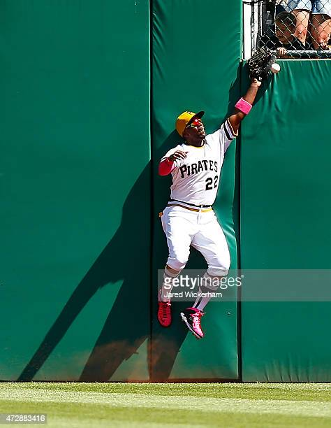 Andrew McCutchen of the Pittsburgh Pirates fails to come up with a catch in the seventh inning against the St Louis Cardinals during the game at PNC...