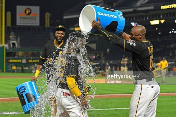 Andrew McCutchen of the Pittsburgh Pirates gets a bucket of water dumped on him by Starling Marte after the final out in the Pittsburgh Pirates 101...