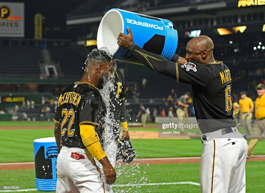 Andrew McCutchen #22 of the Pittsburgh Pirates gets a bucket of water dumped on him by Starling Marte #6 after the final out in the Pittsburgh Pirates 10-1 win over the Baltimore Orioles at PNC Park on September 26, 2017 in Pittsburgh, Pennsylvania.