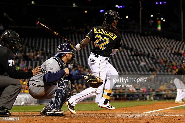 Andrew McCutchen of the Pittsburgh Pirates grounds into a fielder's choice to shortstop scoring Starling Marte in the seventh inning against the...