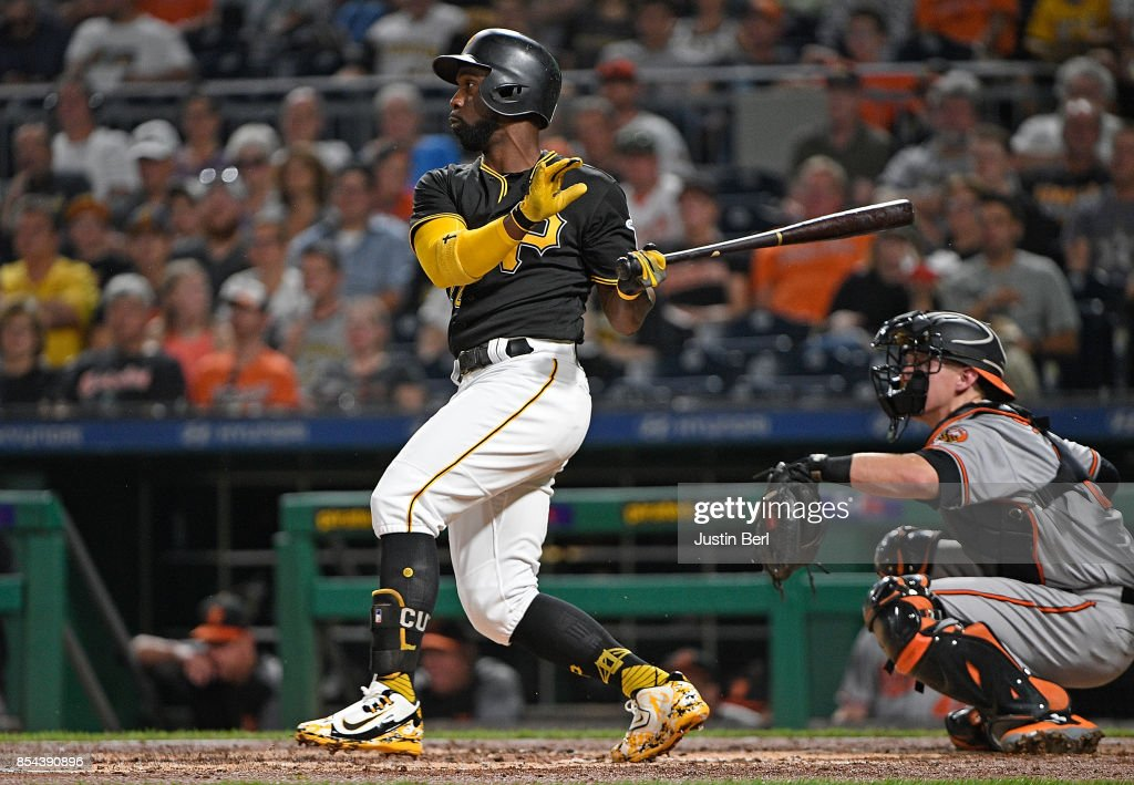 Andrew McCutchen #22 of the Pittsburgh Pirates hits a grand slam home run in the second inning during the game against the Baltimore Orioles at PNC Park on September 26, 2017 in Pittsburgh, Pennsylvania. The grand slam home run was the first of McCutchen's career.