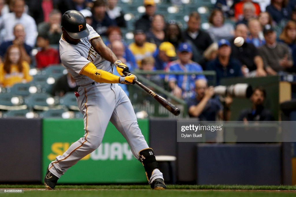 Andrew McCutchen #22 of the Pittsburgh Pirates hits a home run in the first inning against the Milwaukee Brewers at Miller Park on September 11, 2017 in Milwaukee, Wisconsin.