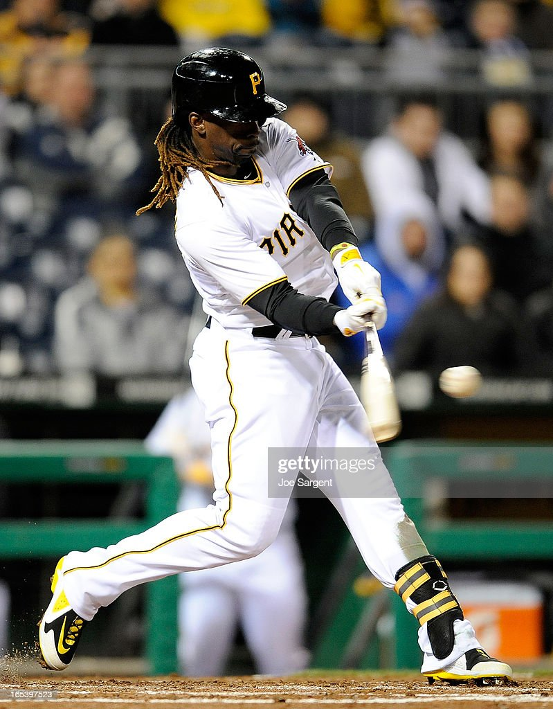 Andrew McCutchen #22 of the Pittsburgh Pirates hits a run scoring a double in the fourth inning against the Chicago Cubs on April 3, 2013 at PNC Park in Pittsburgh, Pennsylvania.