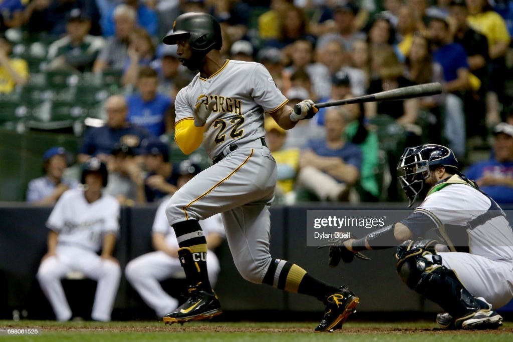Andrew McCutchen #22 of the Pittsburgh Pirates hits a single in the seventh inning against the Milwaukee Brewers at Miller Park on June 19, 2017 in Milwaukee, Wisconsin.