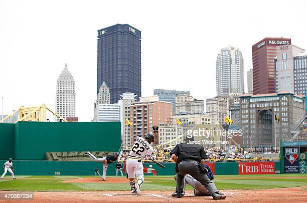 Andrew McCutchen of the Pittsburgh Pirates hits an RBI single in the first inning against the Milwaukee Brewers during the game at PNC Park on April...