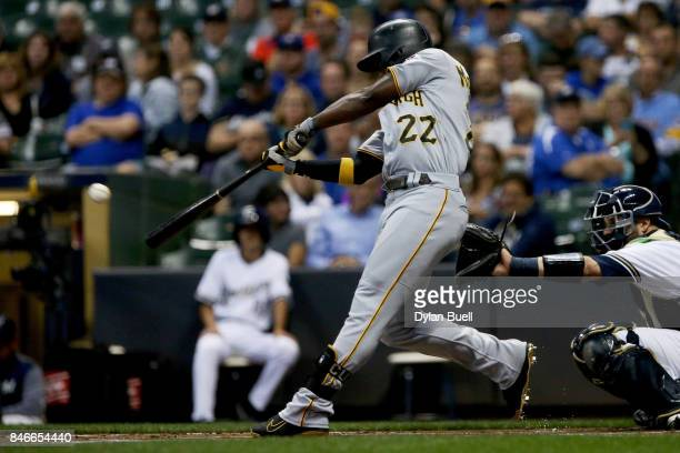 Andrew McCutchen of the Pittsburgh Pirates hits his 200th career home run during the first inning against the Milwaukee Brewers at Miller Park on...