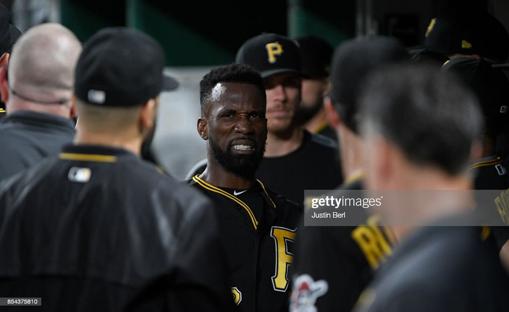 Andrew McCutchen #22 of the Pittsburgh Pirates is greeted teammates in the dugout after coming around to score on an RBI double by Josh Bell #55 in the first inning during the game against the Baltimore Orioles at PNC Park on September 26, 2017 in Pittsburgh, Pennsylvania.