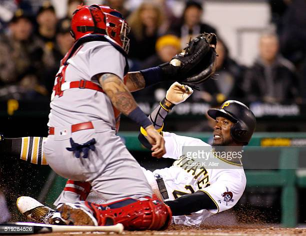 Andrew McCutchen of the Pittsburgh Pirates is tagged out at home by Yadier Molina of the St Louis Cardinals in the third inning during the game at...