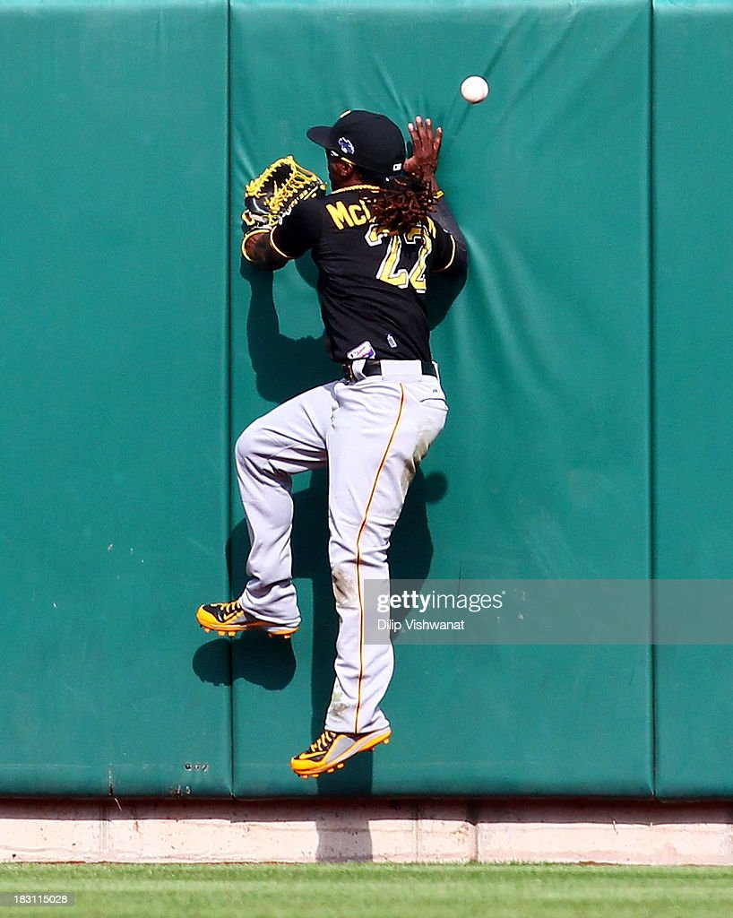 Andrew McCutchen #22 of the Pittsburgh Pirates is unable to make a catch on a ball hit by Matt Adams #53 of the St. Louis Cardinals in the ninth inning during Game Two of the National League Division Series at Busch Stadium on October 4, 2013 in St Louis, Missouri.