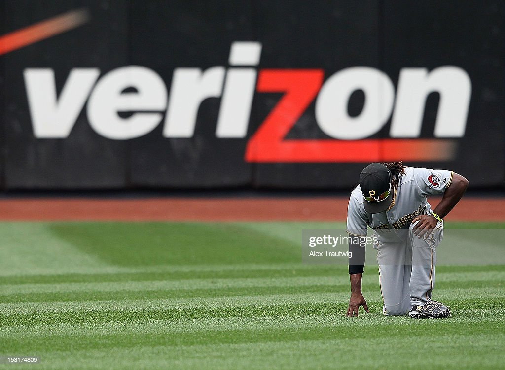 Andrew McCutchen #22 of the Pittsburgh Pirates leaves the field after making a diving catch against the New York Mets at Citi Field on September 27, 2012 in the Flushing neighborhood of the Queens borough of New York City.