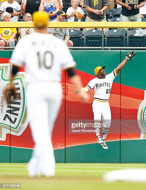 Andrew McCutchen of the Pittsburgh Pirates makes a catch at the center field wall in the first inning against the Philadelphia Phillies during the...