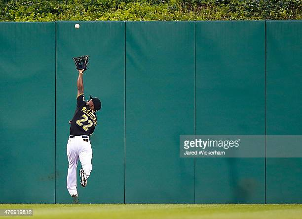 Andrew McCutchen of the Pittsburgh Pirates makes a running catch in center field in the second inning against the Philadelphia Phillies during the...