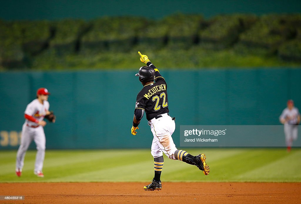 Andrew McCutchen #22 of the Pittsburgh Pirates reacts after hitting the game-winning two run home run in the 14th inning against the St Louis Cardinals during the game at PNC Park on July 11, 2015 in Pittsburgh, Pennsylvania.