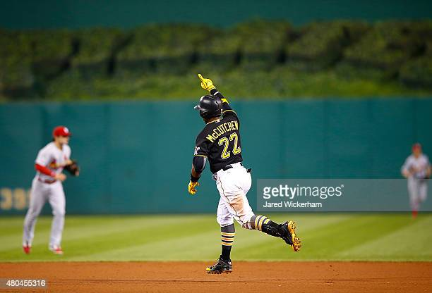 Andrew McCutchen of the Pittsburgh Pirates reacts after hitting the gamewinning two run home run in the 14th inning against the St Louis Cardinals...