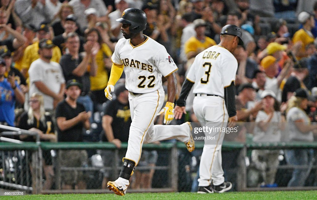 Andrew McCutchen #22 of the Pittsburgh Pirates reacts as he rounds the bases after hitting a two run home run in the eighth inning during the game against the Colorado Rockies at PNC Park on June 13, 2017 in Pittsburgh, Pennsylvania.