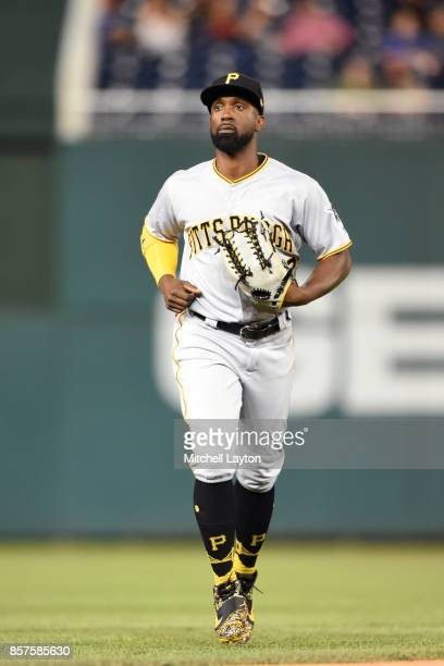 Andrew McCutchen of the Pittsburgh Pirates runs back to the dug out during a baseball game against the Washington Nationals at Nationals Park on...