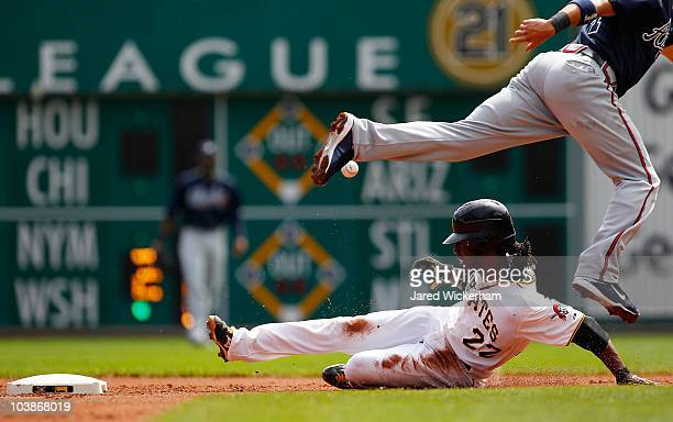 Andrew McCutchen of the Pittsburgh Pirates safely steals second base as the ball is thrown past Omar Infante of the Atlanta Braves during the game on...