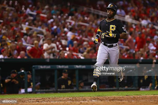 Andrew McCutchen of the Pittsburgh Pirates scores a run against the St Louis Cardinals in the ninth inning at Busch Stadium on August 13 2015 in St...