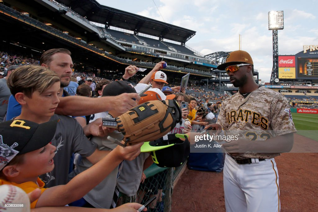 Andrew McCutchen #22 of the Pittsburgh Pirates signs autographs before the game against the Tampa Bay Rays during inter-league play at PNC Park on June 29, 2017 in Pittsburgh, Pennsylvania.