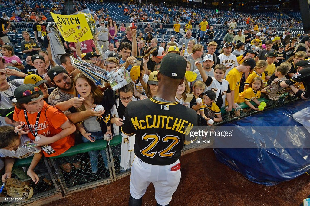 Andrew McCutchen #22 of the Pittsburgh Pirates signs autographs for fans before the start of the game against the Baltimore Orioles at PNC Park on September 27, 2017 in Pittsburgh, Pennsylvania.