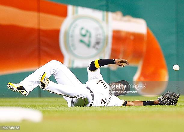 Andrew McCutchen of the Pittsburgh Pirates slides but fails to come up with a catch in center field against the St Louis Cardinals during the game at...