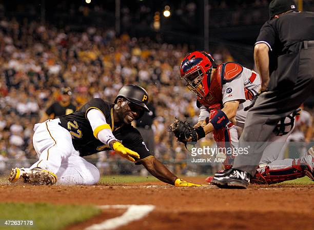 Andrew McCutchen of the Pittsburgh Pirates slides in safe against Yadier Molina of the St Louis Cardinals on a force out at second in the sixth...
