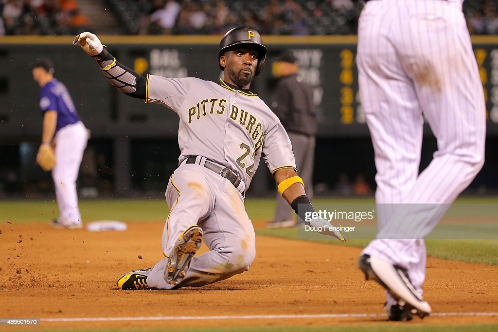 Andrew McCutchen #22 of the Pittsburgh Pirates slides into thirdbase on an RBI single by Aramis Ramirez #17 of the Pittsburgh Pirates off of Brooks Brown #51 of the Colorado Rockies in the ninth inning at Coors Field on September 21, 2015 in Denver, Colorado.