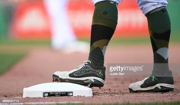 Andrew McCutchen of the Pittsburgh Pirates stands on first base adorned with a Memorial Day logo in the seventh inning during the game against the...