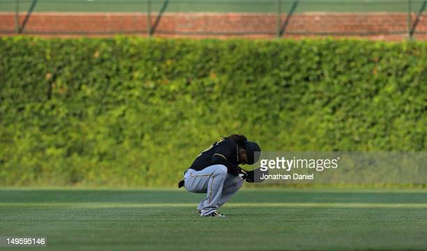 Andrew McCutchen of the Pittsburgh Pirates takes a moment to himself before a game against the Chicago Cubs at Wrigley Field on July 31 2012 in...