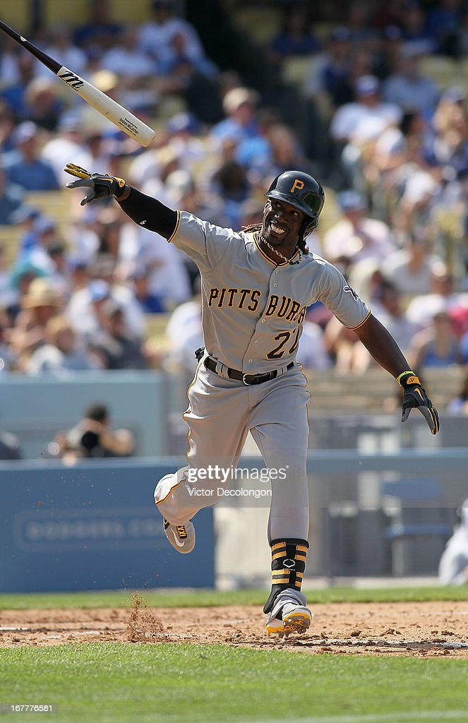 Andrew McCutchen #22 of the Pittsburgh Pirates tosses his bat aside after popping out to right field in the sixth inning against the Los Angeles Dodgers during the MLB game at Dodger Stadium on April 7, 2013 in Los Angeles, California. The Dodgers defeated the Pirates 6-2.