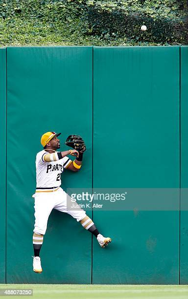 Andrew McCutchen of the Pittsburgh Pirates watches a home run ball clear the fence in the third inning during the game against the Milwaukee Brewers...