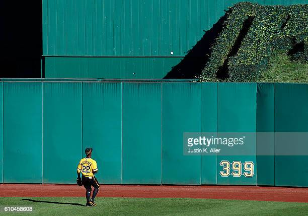 Andrew McCutchen of the Pittsburgh Pirates watches a two run home run go over the fence in the eighth inning during the game against the Washington...