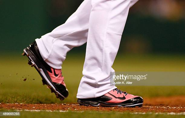 Andrew McCutchen of the Pittsburgh Pirates wear pink Nike mothers day cleats during the game against the St Louis Cardinals at PNC Park May 11 2014...