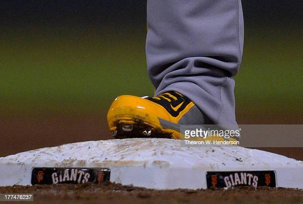 Andrew McCutchen of the Pittsburgh Pirates wearing Nike Baseball cleats stands on first base against the San Francisco Giants at ATT Park on August...