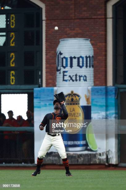 Andrew McCutchen of the San Francisco Giants catches a flyball during the first inning against the Oakland Athletics at ATT Park on July 14 2018 in...
