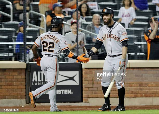 Andrew McCutchen of the San Francisco Giants celebrates his game winning run with teammate Brandon Belt in the 13th inning against the New York Mets...