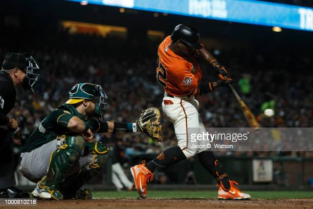 Andrew McCutchen of the San Francisco Giants hits a single against the Oakland Athletics during the sixth inning at ATT Park on July 13 2018 in San...