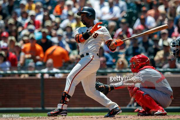 Andrew McCutchen of the San Francisco Giants hits a single against the St Louis Cardinals during the first inning at ATT Park on July 8 2018 in San...