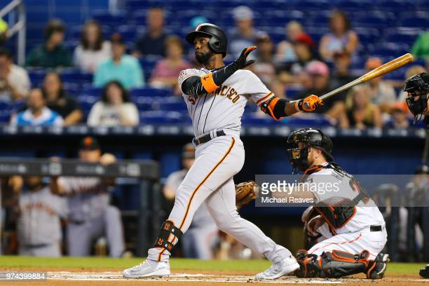 Andrew McCutchen of the San Francisco Giants hits a tworun home run in the first innning against the Miami Marlins at Marlins Park on June 14 2018 in...