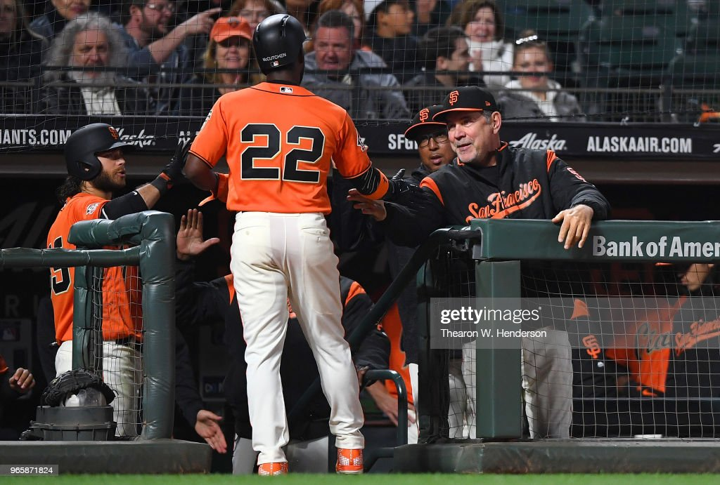 Andrew McCutchen #22 of the San Francisco Giants is congratulated by manager Bruce Bochy #15 after Crawford scored against the Philadelphia Phillies in the bottom of the seventh inning at AT&T Park on June 1, 2018 in San Francisco, California.