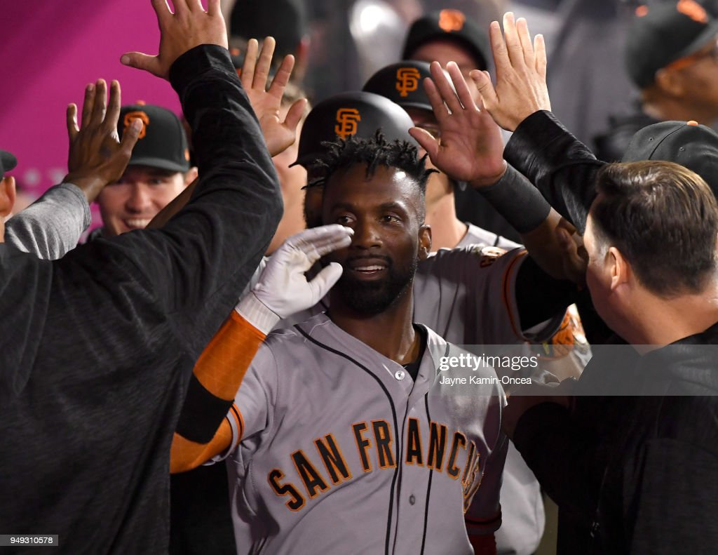 Andrew McCutchen #22 of the San Francisco Giants is greeted in the dugout after a three run home run in the fifth inning of the game against the Los Angeles Angels of Anaheim at Angel Stadium of Anaheim on April 20, 2018 in Anaheim, California.
